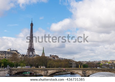 Eiffel tower and Seine river view of city of Paris with Eiffel tower and bridge over Seine river, France.
