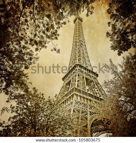Eiffel tower and trees monochrome vintage - stock photo
