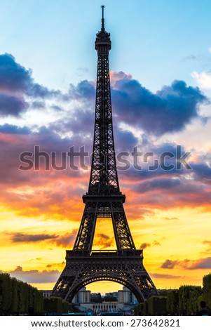 Eiffel Tower at sunset is the most visited monument in France and the most famous symbol of Paris - stock photo