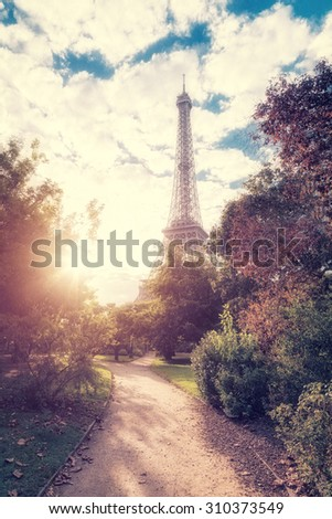 Eiffel tower at sunset. Vintage style photo - stock photo