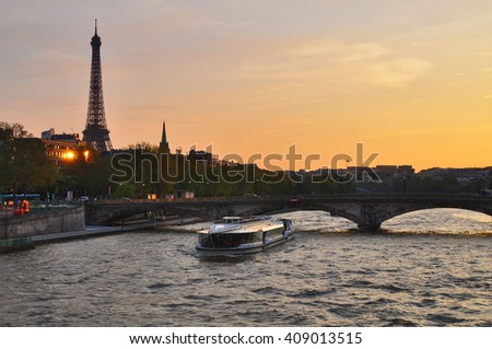 Eiffel Tower by the Seine river, Paris, France - stock photo