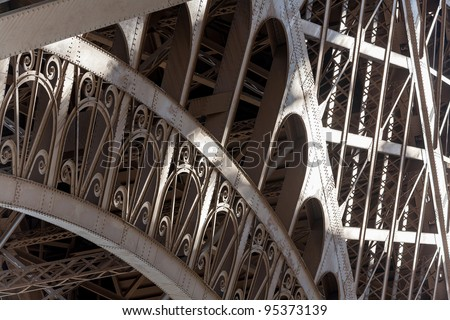 Eiffel Tower detail showing the classic pattern in dappled light