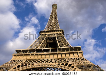 Eiffel tower from bottom looking up - stock photo