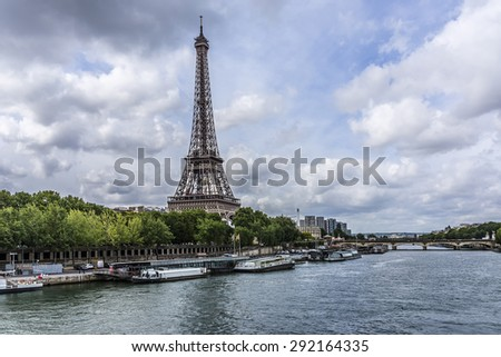 Eiffel tower from the Seine River. Eiffel Tower is tallest structure in Paris and most visited monument in the world. France. - stock photo