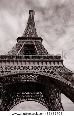 Eiffel Tower in Black and White Sepia Tone with Heart Shape in Clouded Sky in Paris, France