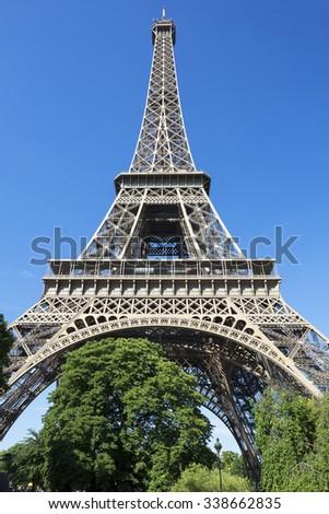 Eiffel Tower in blue sky, Paris, France. - stock photo