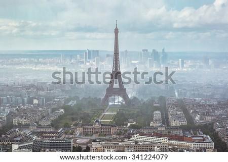 Eiffel tower in fog - stock photo