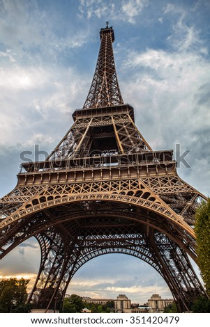 Eiffel tower in Paris against blue sky at day summer time.