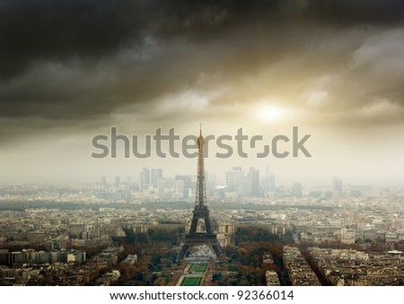 Eiffel tower in Paris and stormy sky - stock photo