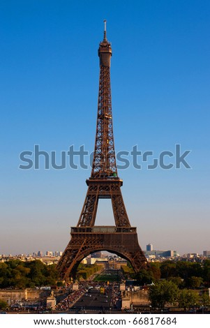 Eiffel Tower in Paris, France on a background of the blue sky - stock photo