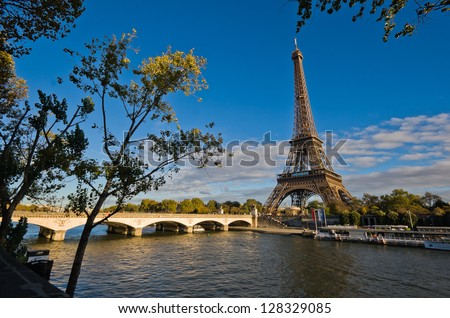 Eiffel Tower in Paris, France - overlooking Seine river at sunset - stock photo