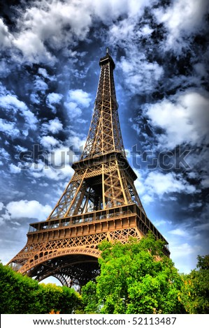 Eiffel tower in Paris, Italy. High dynamic contrast composition - stock photo