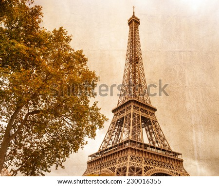 Eiffel tower in Paris on a cloudy day. Vintage style effect applied - stock photo