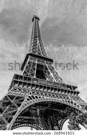 Eiffel Tower (La Tour Eiffel) located on Champ de Mars in Paris, named after engineer Gustave Eiffel. Eiffel Tower is tallest structure in Paris and most visited monument in world. Black and white.