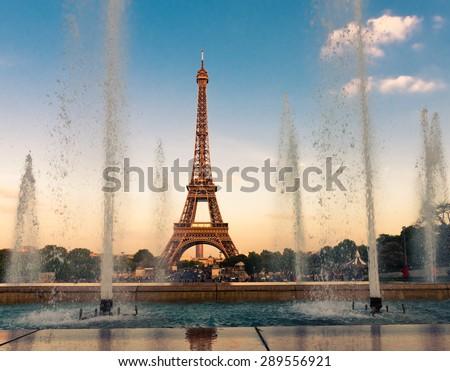 Eiffel Tower (La Tour Eiffel) with fountains. Beautiful sunset landscape in Paris - stock photo