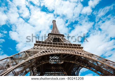 Eiffel Tower low angle view over sky Paris France - stock photo