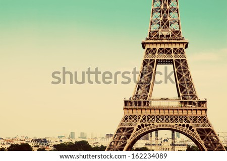 Eiffel Tower middle section, the city in the background, Paris, France. Vintage, retro style - stock photo