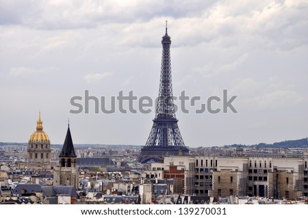 Eiffel Tower on a cloudy day - stock photo