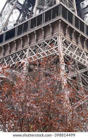 Eiffel Tower, Paris, France, Europe. View of the famous travel and tourism icon at daytime in spring with blooming flowers - stock photo