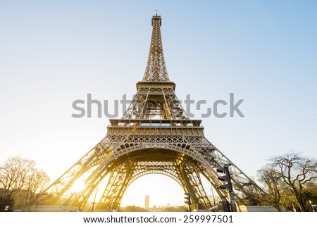 Eiffel Tower, Paris, France with clear blue sky at sunrise - stock photo