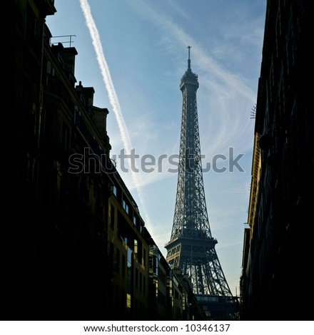 Eiffel Tower,  plane traces. evening. Paris,January 2008 - stock photo