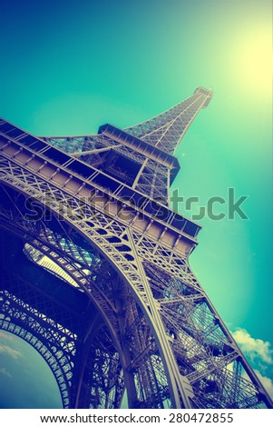 Eiffel Tower reflected in water. Summer in Paris. Travel background with retro vintage instagram filter - stock photo