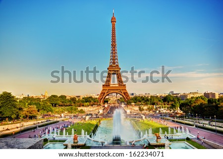 Eiffel Tower seen from fountain at Jardins du Trocadero at a sunny summer day, Paris, France - stock photo