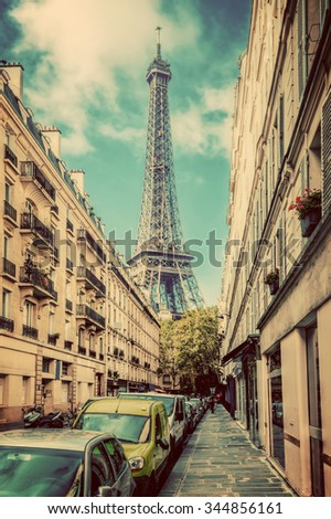 Eiffel Tower seen from the street in Paris, France. Vintage, retro - stock photo