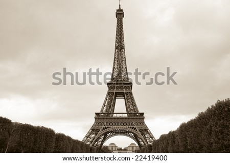 Eiffel Tower sepia toned image with overcast skies taken from Champ-de-Mars