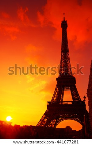 Eiffel Tower silhouette at evening sunset light in Paris France - stock photo