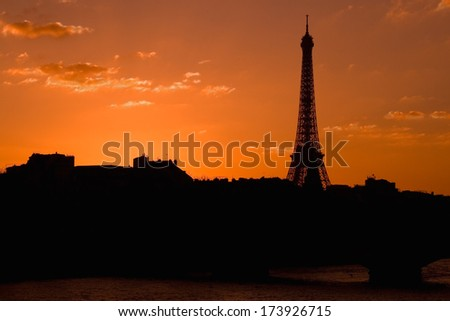 Eiffel tower silhouette from one of the Seine bridges. - stock photo
