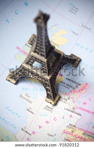 Eiffel Tower statue on a map of Paris