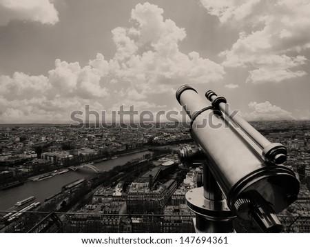 Eiffel Tower telescope overlooking for Paris - stock photo