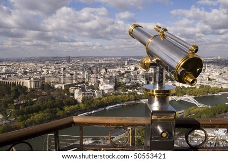 Eiffel Tower telescope overlooking the seine river towards the 8 arrondissment of Paris.