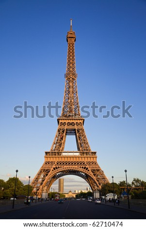 Eiffel tower under last rays of sun. Vertical wide angle. France - stock photo