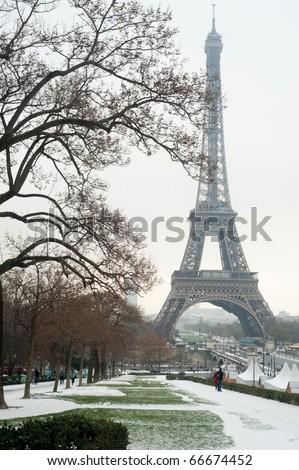 Eiffel tower under snow - Paris - stock photo