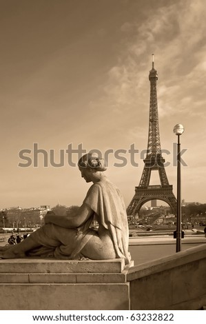 Eiffel tower with a woman's sculpture on the foreground (Paris, France) - stock photo