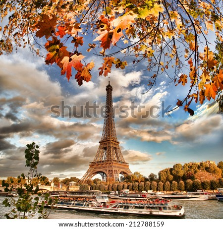 Eiffel Tower with autumn leaves in Paris, France - stock photo