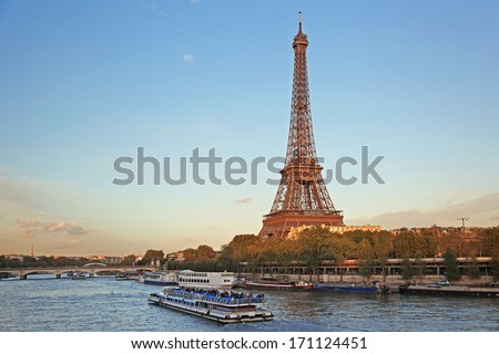 Eiffel Tower with boats in evening Paris, France - stock photo