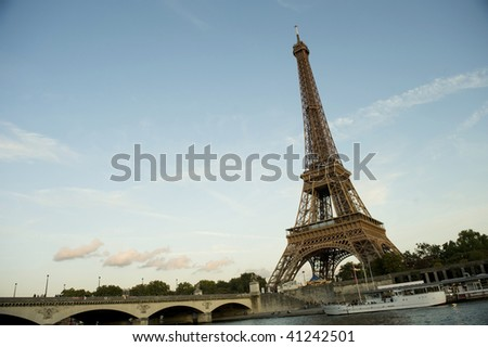 Eiffel tower with bridge Seine river and boats - stock photo