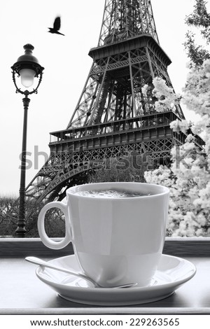 Eiffel Tower with cup of coffee in black and white style,  Paris, France - stock photo