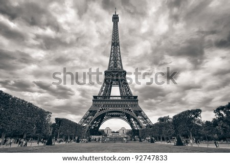 Eiffel tower with dramatic sky monochrome black and white - stock photo