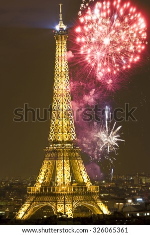 Eiffel tower with fireworks, celebration of the New Year in Paris, France - stock photo