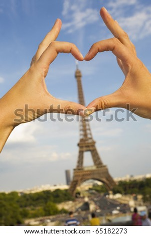 Eiffel Tower with love heart hands. - stock photo