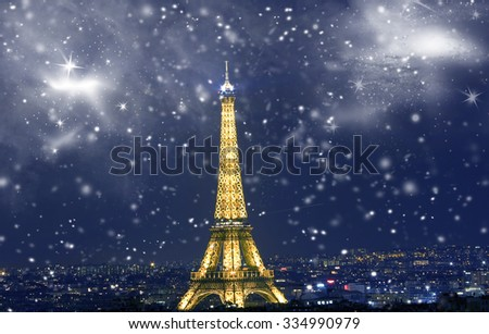 Eiffel tower with snowflakes, celebration of Christmas in Paris, France