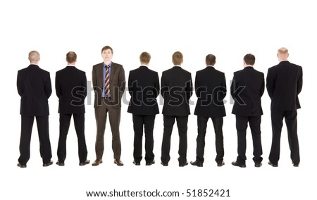 Eight anonymous men and one serious boss - stock photo