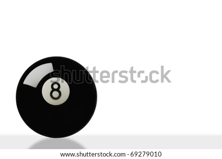 eight ball on white with slight reflection - stock photo