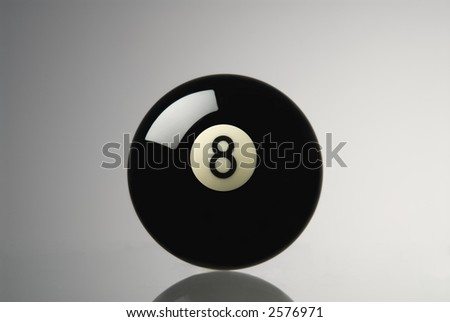 eight ball sitting on a piece of glass,slight reflection, neutral background - stock photo