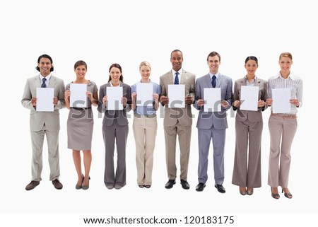 Eight business people holding white support for letters against white background - stock photo