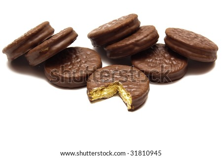 Eight chocolate cookies over white - stock photo